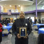 Patrolman Xavier Lynch, a 20 year veteran of the Cleveland Division of Police, displays his Cleveland Police Foundation's Community Service Award, for his outstanding service to both the citizens, and children of the 5th District. Officer Lynch also received The Commander's Commendation Award on this night.