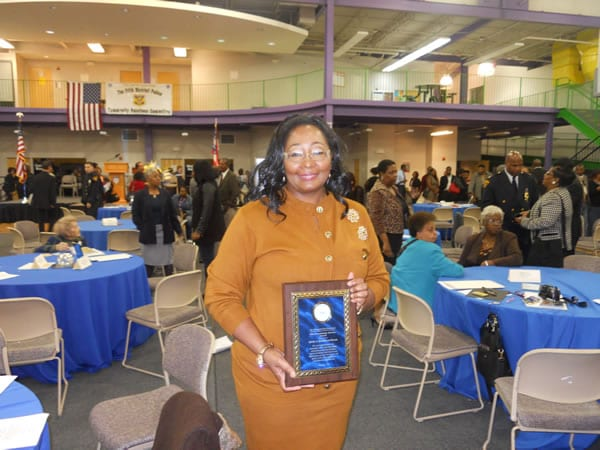 Evangelist Sylvia Henderson Reeves, a community activist in her Glenville neighborhood, proudly displays her Community Service Award presented by The Cleveland Police Foundation.