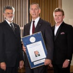 Michael McGrath accepting the Founders Award, also pictured are Mayor Frank G. Jackson and Martin Savidge.