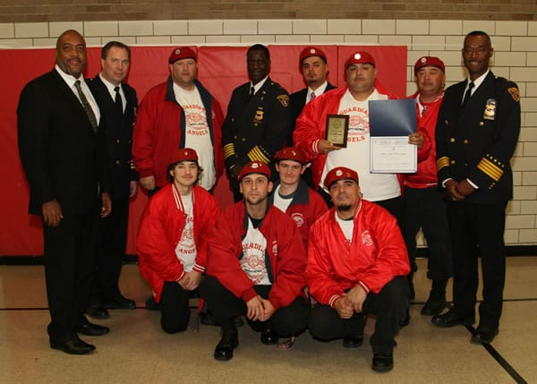 The Cleveland Police Foundation Community Service Award winners Guardian Angels are flanked by from left to right, Community Relation's Executive Director Blaine Griffith, Second District Commander Thomas Stacho, Chief Calvin Williams, and Deputy Chief Dornat Drummond.