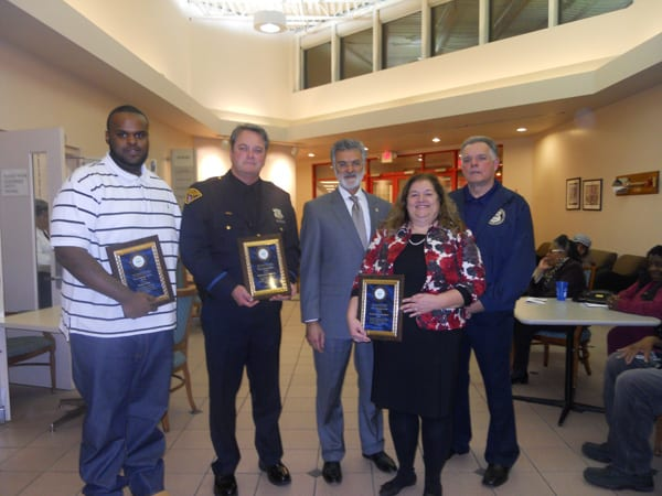 The Cleveland Police Foundation's Community Service Awards recipients proudly display their awards. From L to R: Mr. Dwayne Malone, PO Rick Connolly, Mayor Frank Jackson, Ms. Judy Varne of the Goodrich-Gannet Center, and the CPF's Bob Guttu.