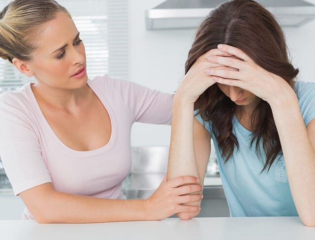 Woman comforting female friend sm