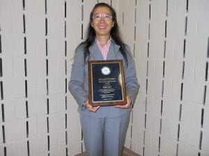 Asian Liaison Cia-Min Chen poses with her much deserved plaque.