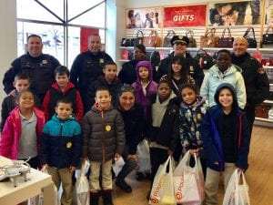 Lots of shopping with the CPD and some terrific kids from Marion Seltzer Elementary School on Tuesday December 12 added up to new shoes and socks at Payless!