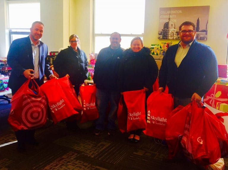 Nearly 100 generous elves came out on a blustery winter day to support the Skylight Foundation Holiday Toy Drive Networking Event on December 13