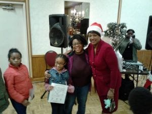 """The Cleveland Police Foundation was able to support """"Christmas Gifts from Lolo"""", a Christmas event on the West Side for hundreds of children from families in need! Loretta Hall, Lolo, battling breast cancer, had made a tradition of always helping families in need during the Christmas season."""