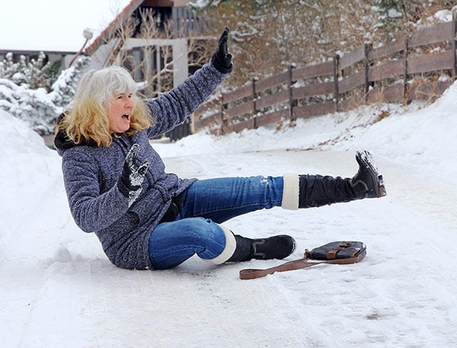 Woman falling on ice