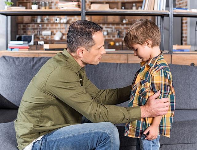 Child telling dad something