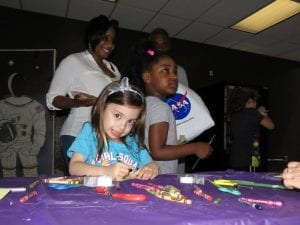 The Cleveland Police Foundation and Cops for Kids spent Saturday at Burke Lakefront Airport at the International Women's Air and Space Museum's Free Family Day. Cleveland Police officers from Community Policing and the 3rd District passed out gift bags with stuffed animals and police coloring books, crayons, and badges.