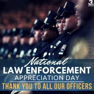 Rows of officers solemnly face left to honor national law enforcement appreciation day.