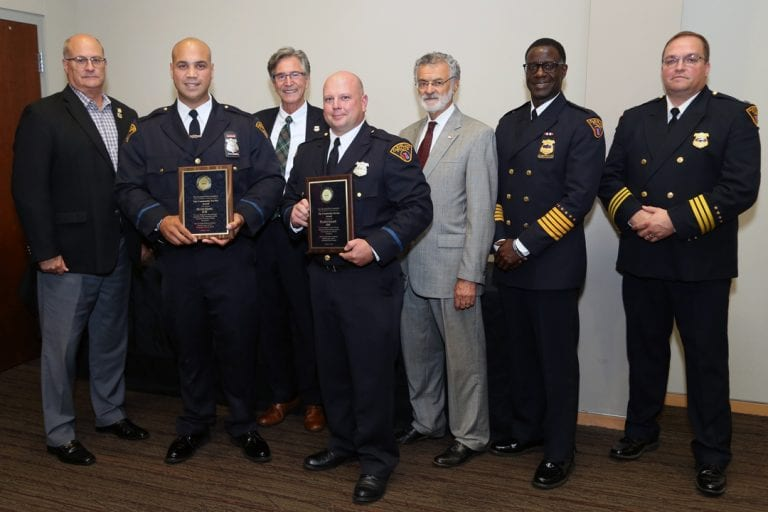 Patrol Officers Erik Melendez and John Greczanik with their Community Service Awards